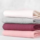 Как отстирать кухонные полотенца от застарелых пятен при помощи растительного масла: два проверенных рецепта